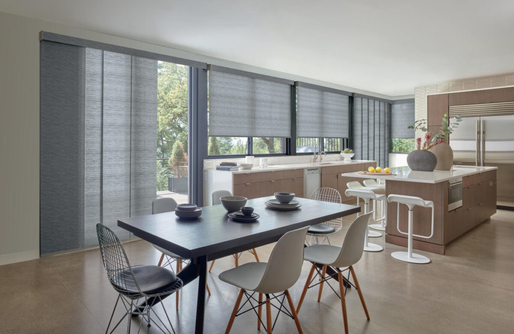Designer roller shades in open layout kitchen