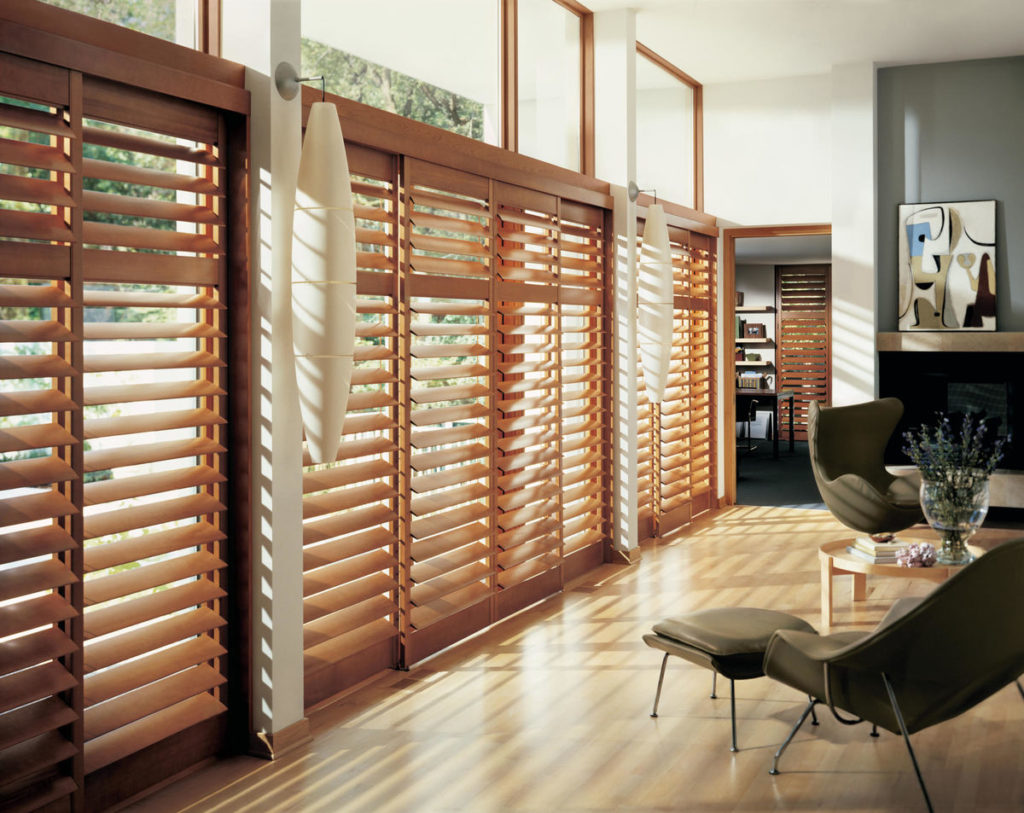 Wall of sliding doors with Heritance® Hardwood Shutters